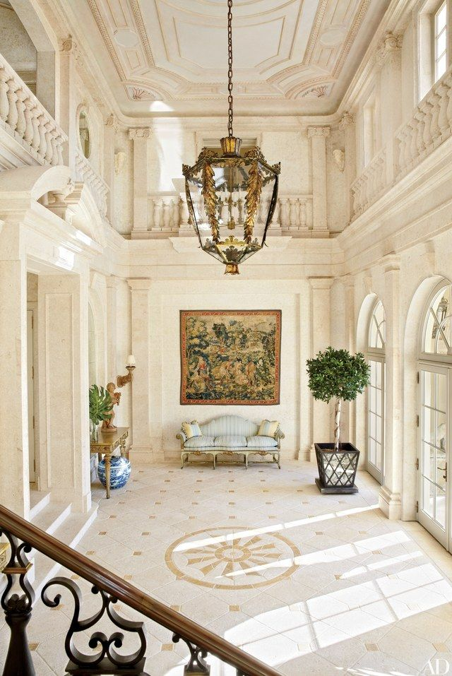 A 16th-century Flemish tapestry hangs in the entrance hall of Amado, a circa-1920 Palm Beach, Florida, mansion built by architect Addison Mizner and renovated by David Easton.   archdigest.com