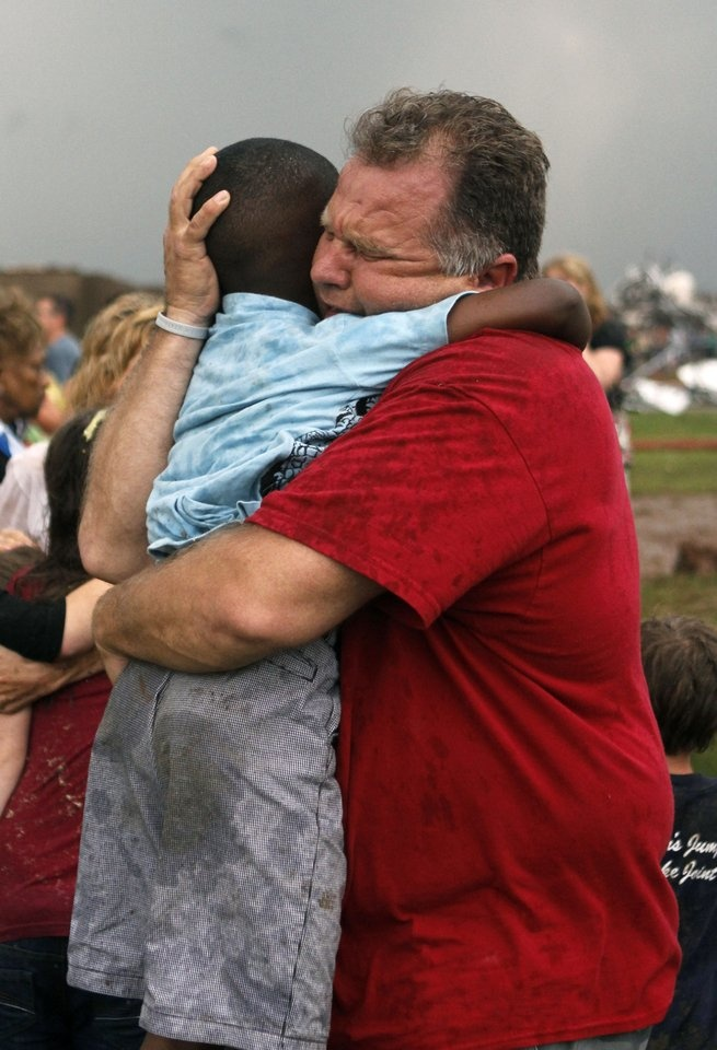 Hearts, Love, Prayers to Oklahoma. A teachers hugs a child at Briarwood Elementary school after a tornado destroyed the school in south OKC Oklahoma City, OK, Monday, May 20, 2013. Near SW 149th and Hudson. By Paul Hellstern, The Oklahoman