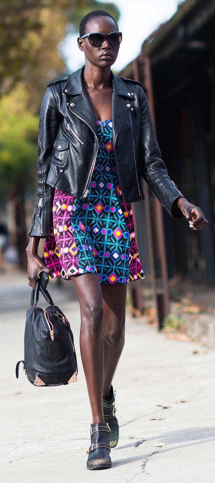 Try a bold printed dress with model-off-duty staples like a leather moto jacket and studded boots