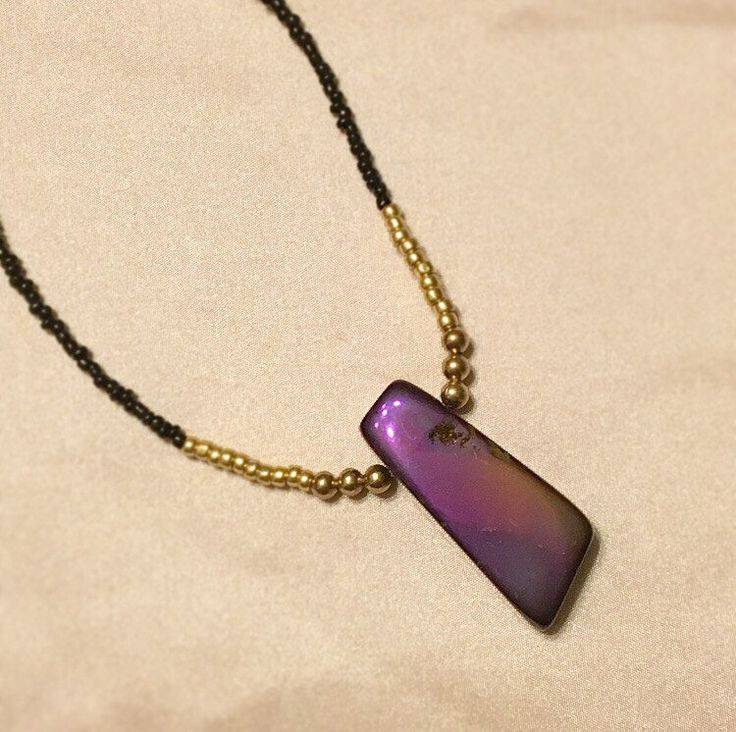 A personal favorite from my Etsy shop https://www.etsy.com/ca/listing/523907061/beaded-choker-necklace-purple-pendant
