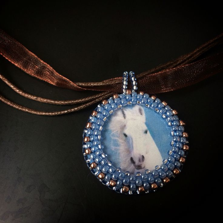BW61 Gentle beaded necklace / pendant with a white horse