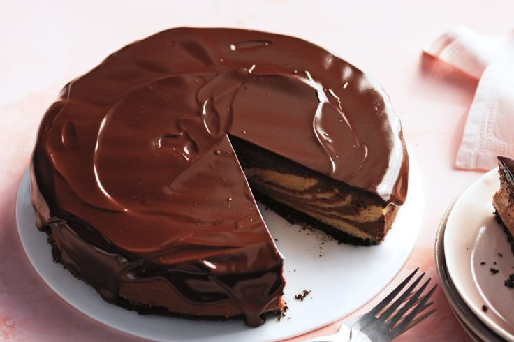 Martha Stewart's decadent cheesecake is a fresh take on a familiar combination. The glossy chocolate glaze goes on like satin.