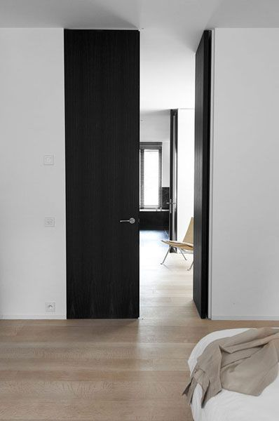 Full height door? Cost saving idea: paint the door colour all the way to the ceiling.