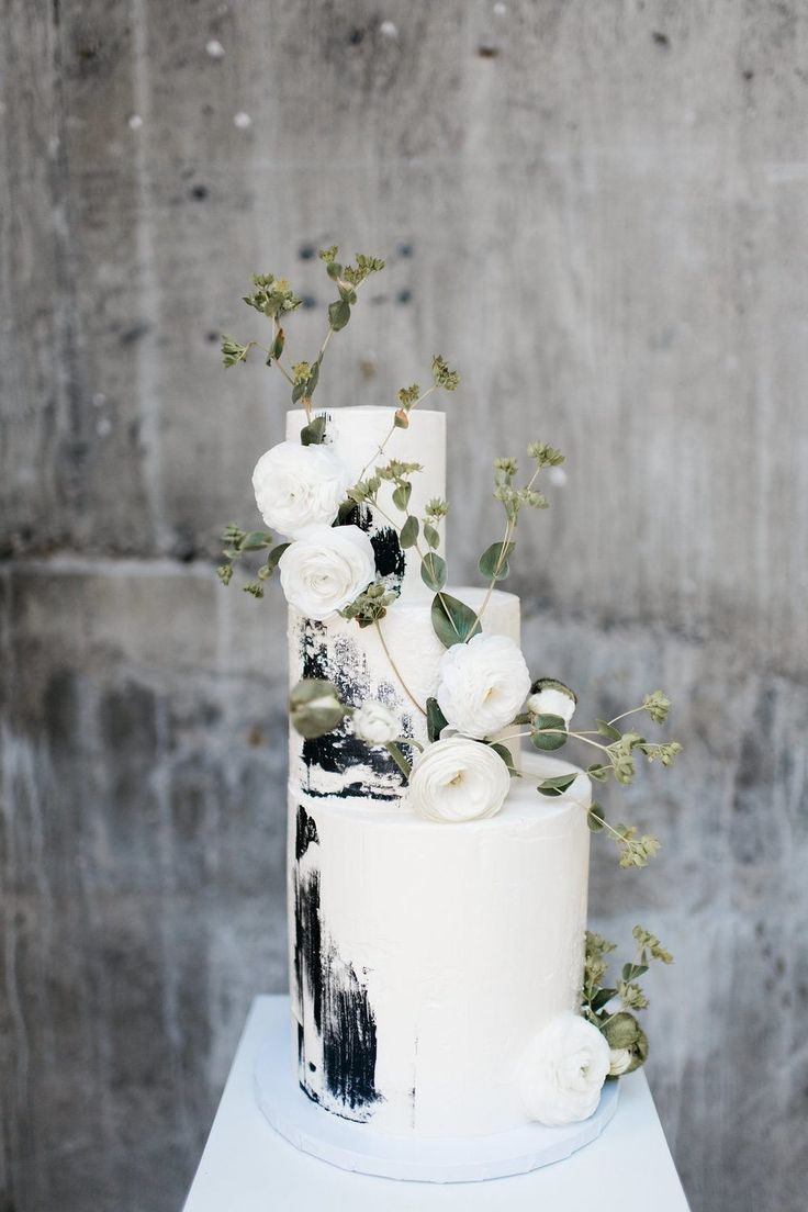 Beaded bridal gowns, neutral tablescapes and a concrete texture cake rule the day in this monochromatic wedding inspiration that took place in beautiful Washington Modern brides everywhere should bookmark this scene - we promise, the thoughtful details like this black and white wedding cake do not disappoint! #ruffledblog