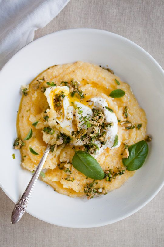 poached egg over soft polenta with olive-herb pesto.