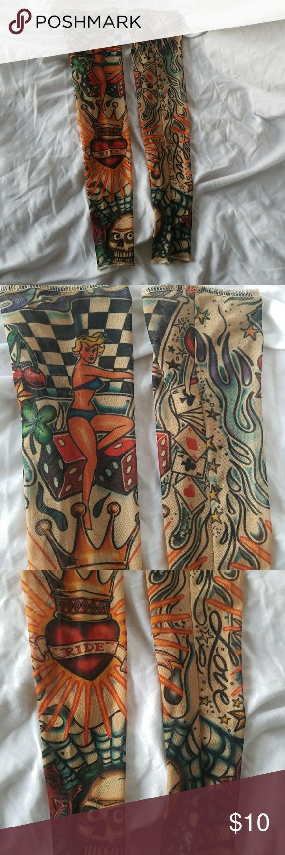 Costume Fake Tattoo Sleeves Fake Tattoo sleeves with elastic hold for upper arm 2 sleeves Covered in classic tattoo imagery - skulls, dice, pin ups, hearts, race check Wore once for a Kat Von D Halloween Costume Other