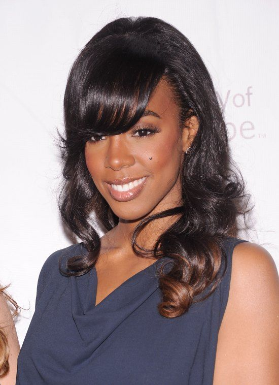 We're not so sure about this look. Perhaps there's a bit too much height at the crown? #kellyrowland #hair