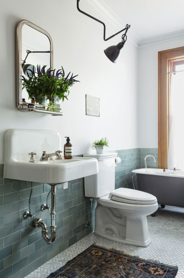 Blue grey tile . Claw foot tub . White and rustic touches . Boho eclectic bathroom. Rug. Need a bathroom large enough to take camera.