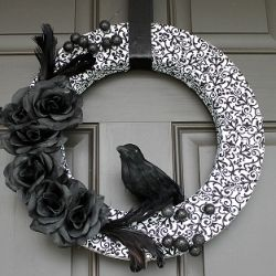Fabric wrapped foam wreath with raven inspired embellishment.