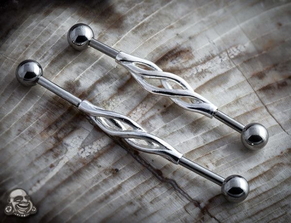 Industrial piercing- this one is cool but I want  one simple and classy - I like one I found with a dragon fly charm in the middle- hate the arrow or colored ones