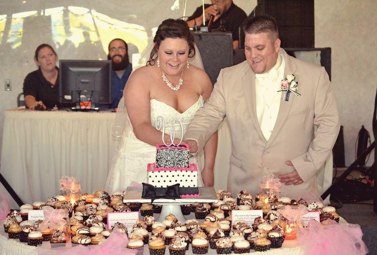 wedding cake and cupcake display