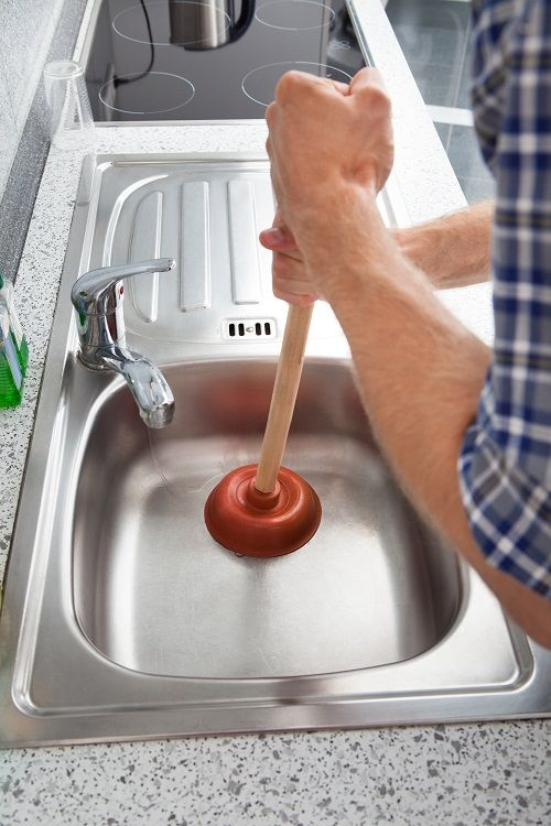 How To Fix A Clogged Kitchen Sink