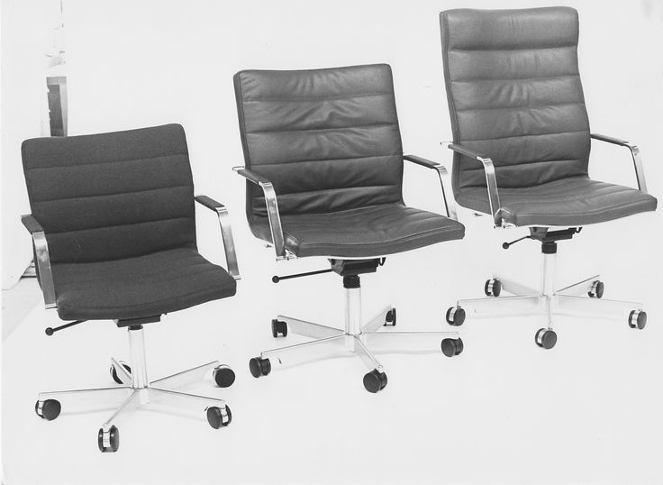 A trio of executive chairs in black and white. Designed by Jørgen Lund and Ole Larsen.