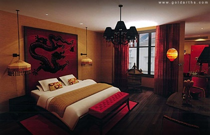 Oriental bedroom...not my typical style and with tweaks would work but something seems cozy. perhaps the orange light.