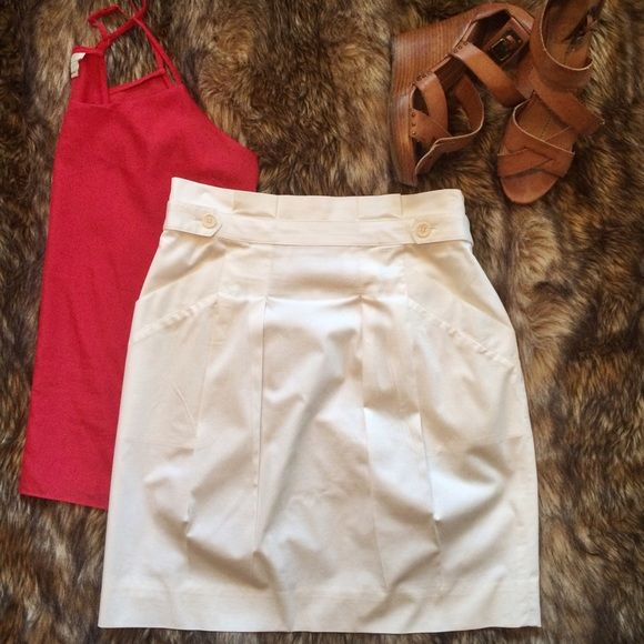 """Moving saleWhite BCBGMaxAzria Skirt This white BGBGMaxAzria skirt is so flattering! It has front buttons and is gathered at the top. It has one microscopic stain on the front, shown in the 3rd picture. I'm 5'6"""" and pictured wearing it. BCBGMaxAzria Skirts Midi"""