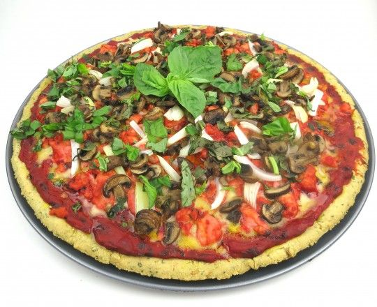 Paleo Pizza with Barbecued Chicken. This Pizza is a full meal deal, alive with the flavor of tender barbecued chicken chunks, mushrooms and onions. I prefer Pizza with cheese, so I top it with Vegan Mozzarella Cheese, an option that adds delicious richness to every bite. The crust is like a focaccia crust, with yummy savory herbs.