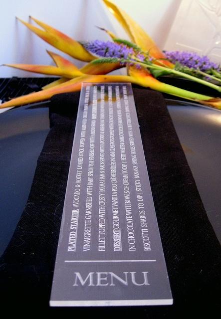 This ultra modern menu is laser engraved on clear perspex.    www.facebook.com/RubyGreyCreative