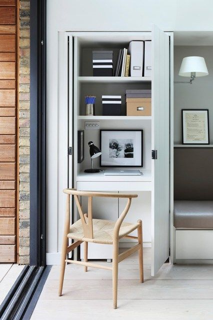 A small workspace with space-saving pocket doors is concealed in a kitchen cupboard in this Victorian terrace house in west London by Clare Stevenson and Claire Sa, from architectural practice De Rosee Sa.
