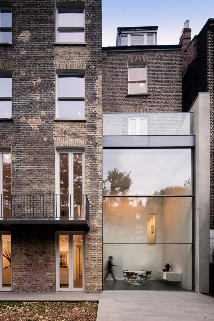 """House on Bassett Road is a contemporary renovation and remodeling of a Victorian town house in Kensington, West London by Paul+O Architects. The project incorporates a double-height glazed extension to the rear featuring a unique motorized sash-window."""