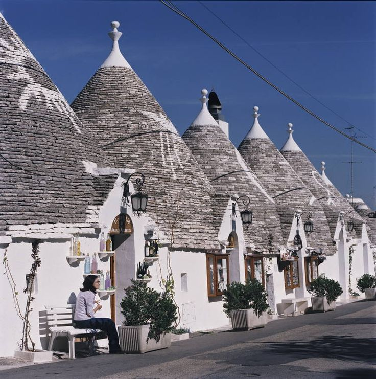 "Alberobello - Apulia, Italy * In the heel of the boot-shaped Italian peninsula, the centuries-old ""trulli"" in Alberobello are whitewashed, conical-roofed houses with beehive-like shapes and mysterious rood-top decorations.  There are as many as 1,500 trulli in and around Alberobello, many now serving as tourist shops, restaurants, inns, and even the occasional church."
