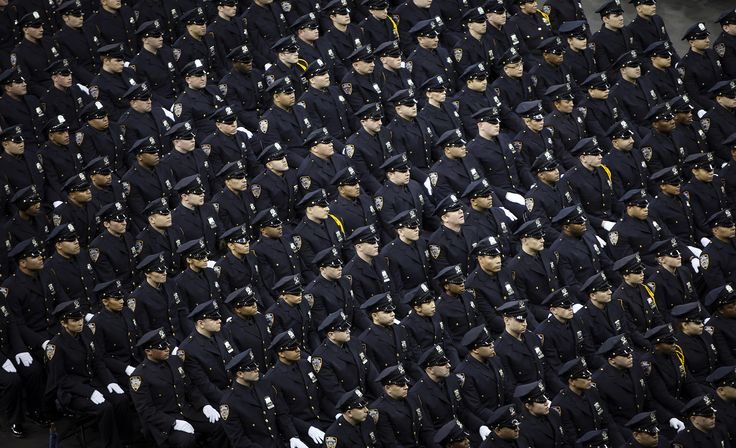 NYPD graduates attend their induction ceremony at Madison Square Garden in NYC, December 27, 2013. The NYPD graduated 1171 recruits to ranks of police officer. [REUTERS/Carlo Allegri]