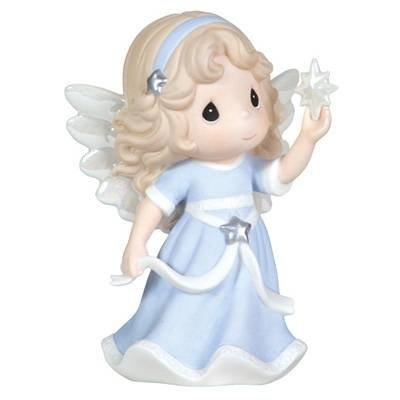 """$35.50-$40.00 Precious Moments Annual Angel Holding Star Figurine """"Hope Shall Light The World"""" First in Series - Hope Shall Light The World. First in a new series of holiday angels, this ethereal beauty holds a star of wonder as she shares her message of hope. Opalescent wings and other accents will find you gazing in awe. What an uplifting gift for anyone in need of inspiration. Bisque porcelai ..."""