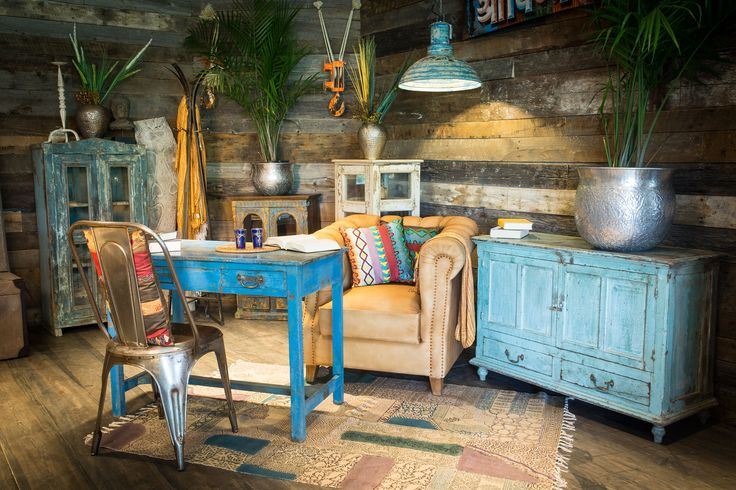 Adventure deco for an indian jungle inspired home. Blue colonial pieces offer bold splashes of color to liven up any space.