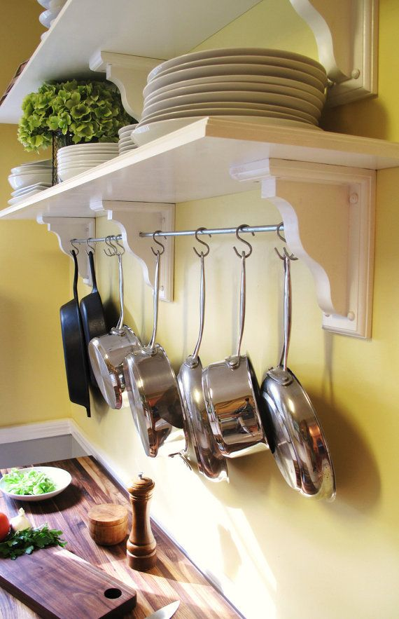 Kitchen shelving with pot rack. I have a pot rack and it's awesome (in fact, my mom even copied it!), but adding the shelves above would be cool.