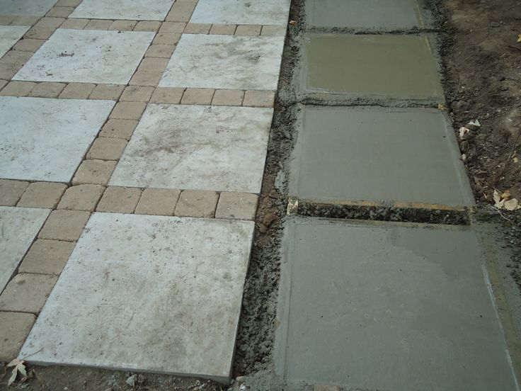 Patio project Poured 2 x 2 concrete squares and put tumbled 6 x 6 pavers in between