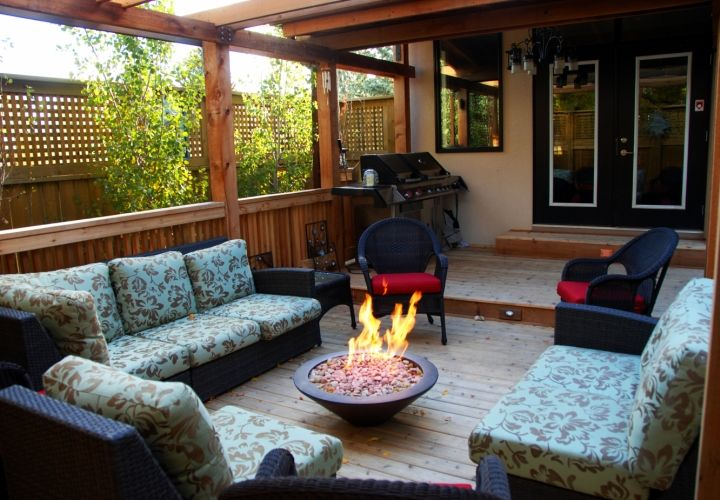 A fire bowl in full use. This offers our client a beautiful way to enjoy the warmth from the fire year round. #custombackyard #winterlandscaping