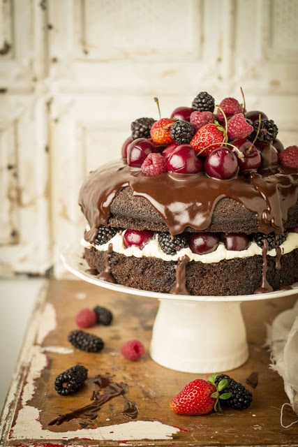 Guiness chocolate cake with cream, berries, and chocolate ganache