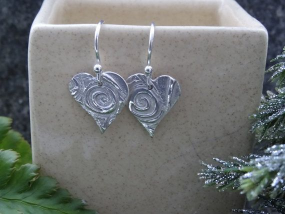 Beautiful handmade silver drop heart earrings.   The beautiful swirl texture on these silver heart earrings catches the light to give a fantastic sparkle and shine.  A beau... #nature #naturelover #style #trend #hmuk #love #girlfriend