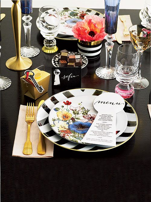 Black and gold décor by Stacey Bendet