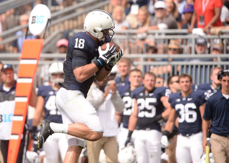 PENN STATE – FOOTBALL 2014 – JESSE JAMES catches 44-yard pass from Hackenberg for game's final touchdown, and crowd cheers clinching score.