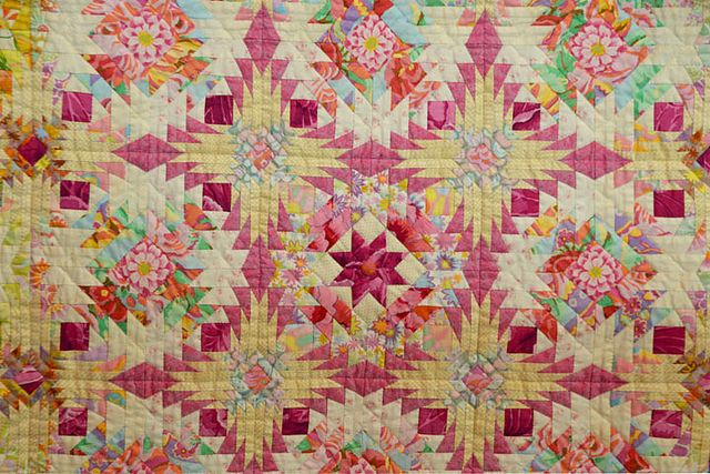 """Closeup of """"Start Again"""" by Kimie Yanagisawa, shown at the Jan 2011 Tokyo Quilt Festival. Note how she uses large scale fabrics, cutting into small pieces to integrate into the overall patchwork pattern.: Patchwork Patterns, Kimieyanagisawa2 W, Scrap Quilts, 2011 Tokyo, Color Combos, Kimi Yanagisawa, Pineapple Quilts, Tokyo Quilts, Quilts Festivals"""