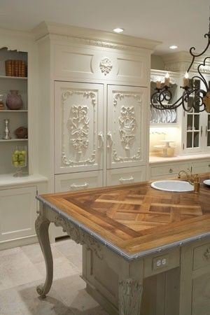 French inspired fridge / dining table could be repurposed on platform as kitchen island.