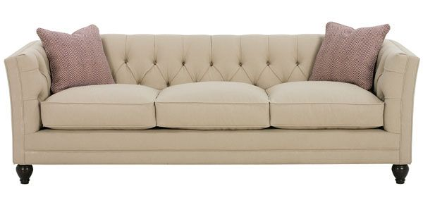 An attractive sleeper sofa that may stand up to our boys-the tufting looks like it will maintain its shape.