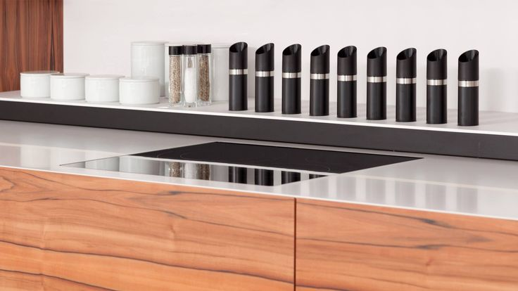 """Innovative idea for a """"wall"""" kitchen. It is a fully functional kitchen including all necessary devices and storage spaces. When closed the kitchen appears as a solid wall surface. Pushing the switch, either remotely or manually, brings out the kitchen which comes sliding smoothly 'out of the wall'."""