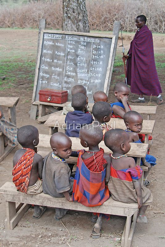 Tanzania, Africa by Adrian Paul. A small group of young Maasai children at their outdoor school village school in Northern Tanzania.