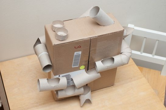Wrap around or through a cardboard box