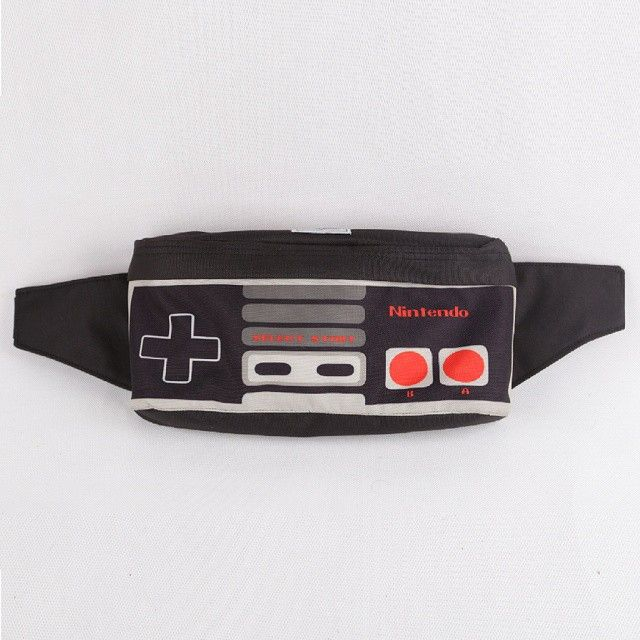 "Now Gamers too have a way to brag 'em self 'bout their way of traveling, oohhh yeah that's the sweetest way of redemption and payback!!, our Waist Bag Nintendo originally designed by Cub Traveler is #1 gamers friend for traveling and one from ""must have"" stuff of gamers list!!, IDR: 200,000, For complete INFO & ORDER detail just check our BOARD, #bags #bag #waistbags #waistbag #modernoutdoorsman #urbantraveling #urban #traveling #traveler #nintendo #videogames #joysticks #products #outdoor"