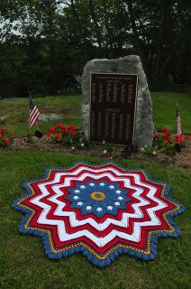 It's easy to honor our veterans with a red, white, gold, and blue afghan cleverly depicting stars and stripes in this patriotic round ripple design by Sue Solakian, done in Red Heart With Love, Super Saver, and Super Tweed yarns.