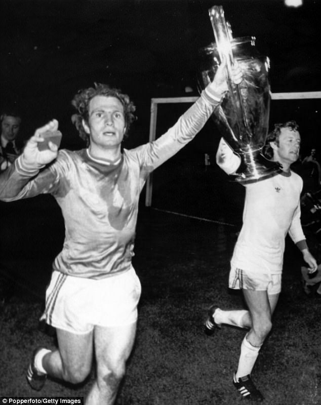 Bayern Munich's Uli Hoeness (left) and Jonny Hansen parade the European Cup in 1976 with the German side the last to win the trophy three years consecutively