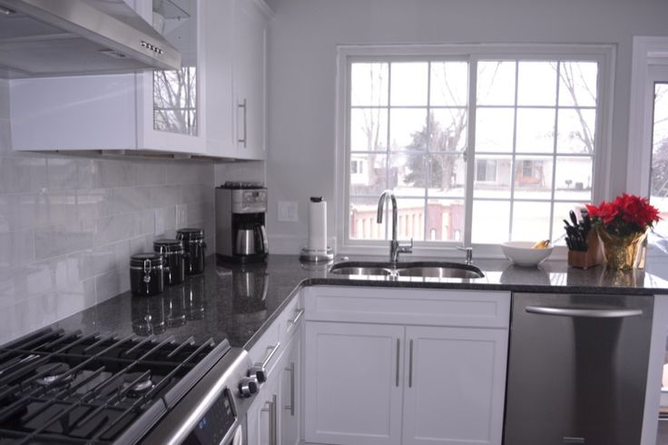 kitchens - white cabinets, steel gray granite, carrara marble backsplash, steel gray granite counters, steel gray granite countertops,  new kitchen
