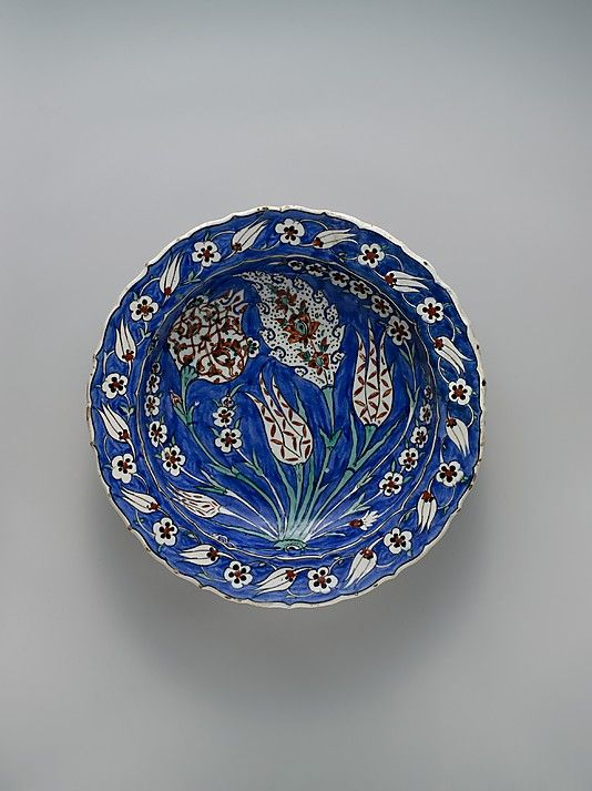 Blue-ground Dish with Floral Design     ca. 1560 Geography:    Turkey, Iznik