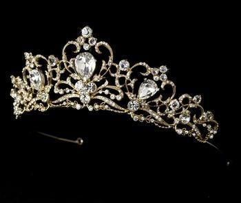 Simply stunning, this royal tiara features sparkling rhinestones and a gold plated curling design.
