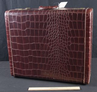 LADY GALE LUGGAGE WOMEN'S SUITCASE. FAUX ALLIGATOR SKIN WITH BROWN LINING. NUMEROUS POCKETS AND HANGERS ON A RACK. MISSING ONE LATCH. SECOND SUITCASE IS QUITE WEATHERED. IT HAS NUMEROUS COMPARTMENTS AND HAS SOME SEAM SEPARATION.