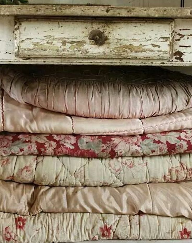 stack of vintage English eiderdowns