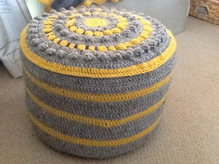 Grey and yellow crochet foot stool cover by Nic underwood.