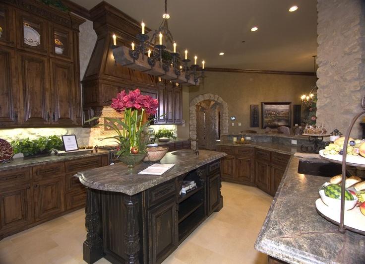 Kitchen with distressed knotty alder cabinets limestone